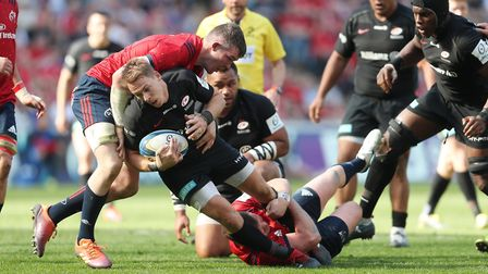 Saracens' Liam Williams is tackled by Munster's Peter O'Mahony and David Kilcoyne during the Europea