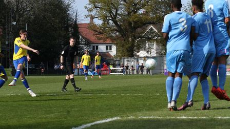 Tom Bender hits a free-kick in to the East Thurrock wall. Picture: JIM STANDEN