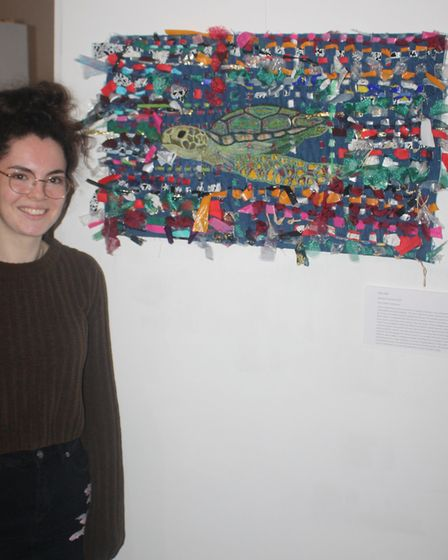 Georgia Tominey-Smith with her artwork 'Help Me' at the St Albans Cathedral exhibition. Picture: Oak