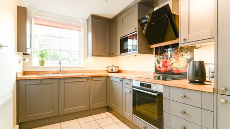 The kitchen is well-proportioned and has a modern appearance. Picture: William H Brown