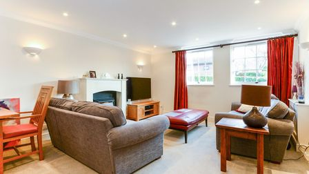 The spacious lounge/dining room which benefits from a feature fireplace with a remote control fire.