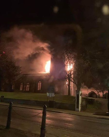 A picture taken at the time of the fire , which broke out at the St John the Baptist church in Royst