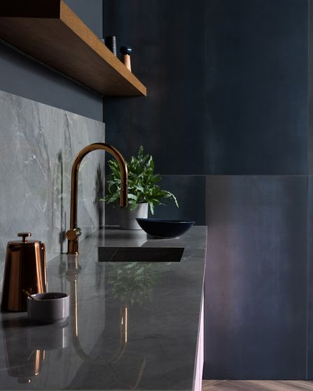 Steel Midnight Blue wall tiles, 49.95 per m2 paired with Noir St Laurent splashback, 69.95 per m2; f