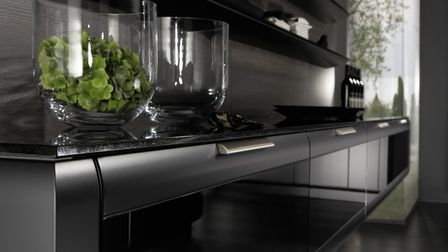The Onda range from Rational has handle-less curved doors. Shown here in a matt black soft lacquer.