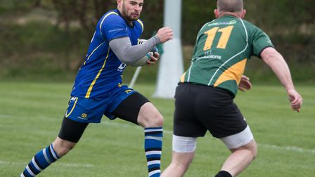 Callum Long on his way to a try for St Ives 2nds in their demolition of Bury St Edmunds 4ths. Pictur