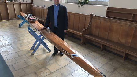 The Rev Tim Robb used a rowing boat for his Easter sermon