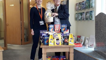 Trudy Lambert, right, presenting chocolate eggs to Jo Adams of Home-Start Royston & South Cambridges