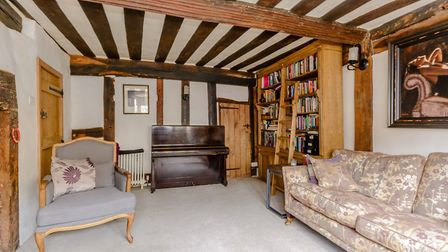The property covers four levels of uneven, timber exposed rooms. Picture: Fine & Country