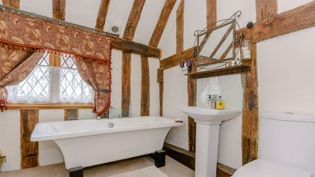 The spacious bathroom is packed with character. Picture: Fine & Country
