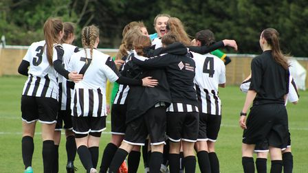St Ives Town Ladies players celebrate their Eastern Region League Division One title triumph. Pictur