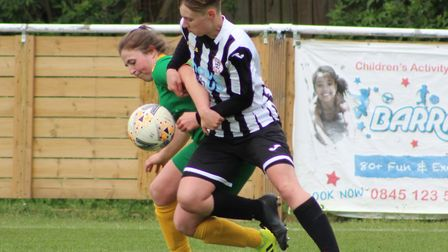 Georgia Stancombe battles for the ball during St Ives Town Ladies' title-clinching victory over Newm