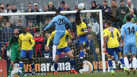 Clovis Kamdjo heads clear for St Albans City. Picture: JIM STANDEN