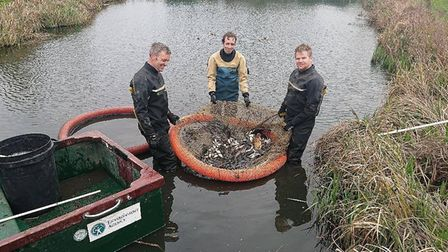 The Environment Agency team at work in Warboys weir. Picture: ENVIRONMENT AGENCY
