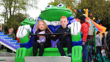 Brother Charlie and Sister Alice enjoy the Frog Merry-Go-Round at the Royston May Fayre 2019. Pictur