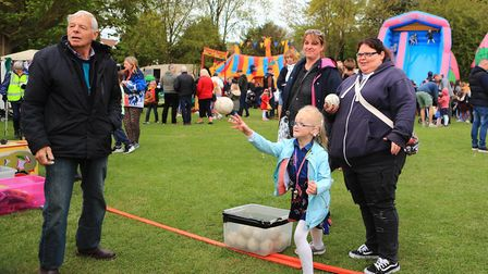 Tara from Heathlands School for the Deaf, St. Albans, visits the Royston May Fayre,t hrowing to win
