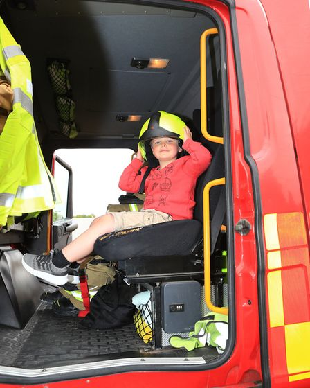 Tom tries on a Fireman's helmet as the Royston Fire Brigade get involved at the Royston May Fayre 20