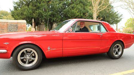 Mr Barnes drives through the town in his 1966 Ford Mustang heading toward the Royston May Fayre 2019