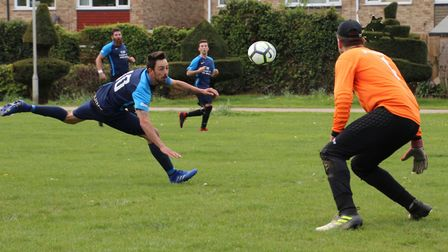 Ashley Kingston heads home Wrestlers' equalising goal against Royston Rangers. Picture: BRIAN HUBBAL