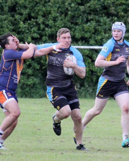 Joe Shaw, with Andy Spencer in support, hands off a Brentwood Eels defender. Picture: DARRYL BROWN