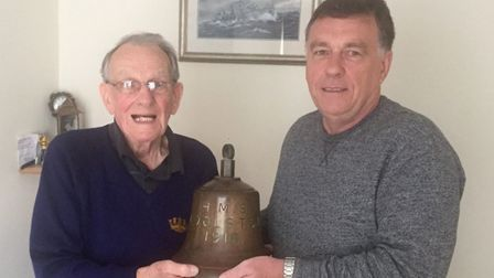 Frank Witton from St Albans and his son Alan with the bell from HMS Woolston. Picture: Bill Forster