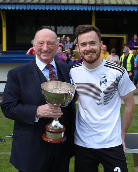 Geoff Golding presents the Golding Cup to Welwyn Warriors' captain Ben Winch. Picture: BRIAN HUBBALL