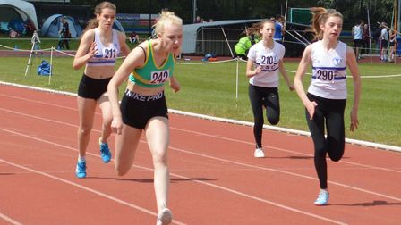 Lizzy Harrison on her way to glory for Hunts AC at the Cambridgeshire County Championships. Picture: