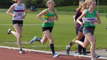 Issy Wilkins on her way to 1500m success for Hunts AC. Picture: SUBMITTED