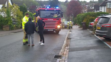 Firefighters rushed to the car fire in Harpenden yesterday. Picture: Andrew Ainger
