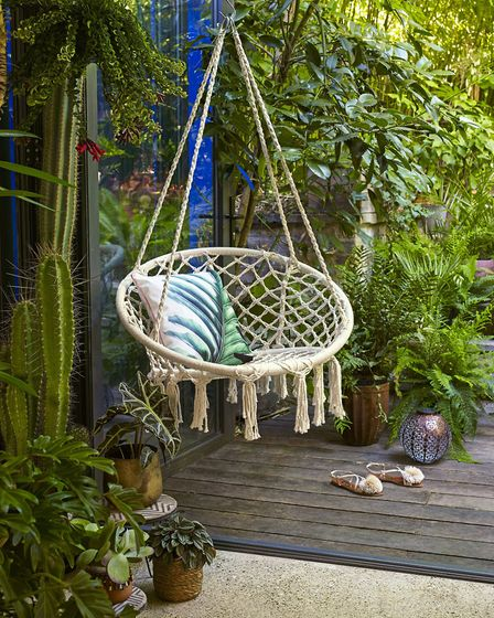 Set Up A Space Just For You: Macrame Hanging Chair, 69.99; Tropical Cushion, 12.99, Dobbies. Picture