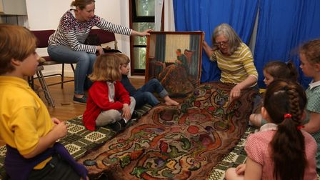 Story teller Kathryn Holt speaks to children about sustainability as part of the Sustainable St Alba