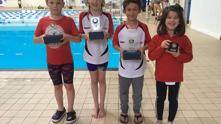The Huntingdon Piranhas trophy-winners are, from the left, Csanad Rehus, Ashlee McCarthy and Kian Le
