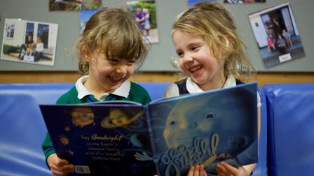 Children at Mount Carmel Kindergarten reading Goodnight Starry, after D'Arcy Lewis visited the schoo