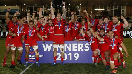 Dom Day the Saracens Storm captain lifts the Premiership Shield after their win over Newcastle Falco