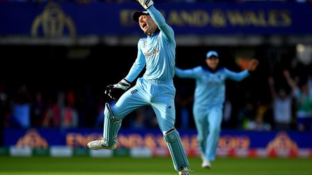 Jos Buttler of England celebrates as he runs out Martin Guptill of New Zealand during the Final of t