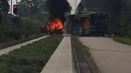 Fire crews are dealing with the bus that is on fire PICTURE: Crystal Cooper