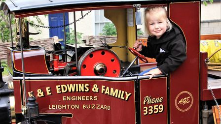 "Abigail Edwins, three, takes control of the family's replica 6"" gauge Foden C Type steam wagon. Pic"