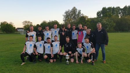 Bassingbourn Football Club celebrate their win in the Foster Cup final over Comberton.