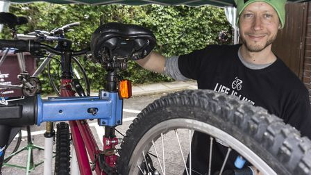 Richard from Botox Bikes helping to repair bikes at the St Luke's Upcycling and Repair Fair. Picture
