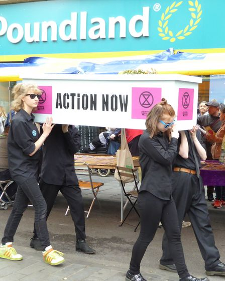 The Extinction Rebellion St Albans funeral march down St Peter's Street during St Albans Sustainabil