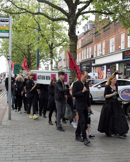 Extinction Rebellion St Albans staged a funeral march for the planet, followed by a colour explosion