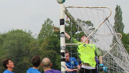 AFC Mymms's keeper tips the ball over the bar. Picture: BRIAN HUBBALL