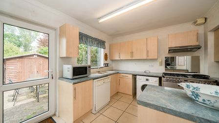 The kitchen opens out onto the patio area to the rear of the property. Picture: Bradford & Howley