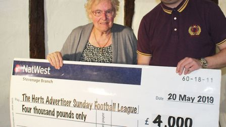 Herts Advertiser Sunday League treasurer Jean Hubball receives the sponsors cheque from Herts Advert