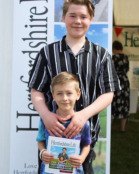Herts County Show 2019 - Oliver Lant, 14, and Charlie Lant, 8, enjoy the Hertfordshire Life Front Pa
