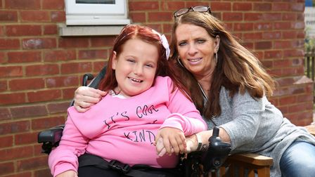 Courtney Copeland, nine who suffers from Spinal Muscular Atrohpy type 2 with her mum Julie. Picture: