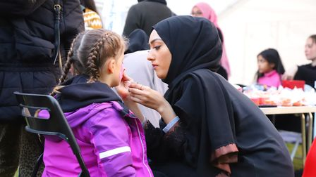 Face-painting for children at the Iftar.