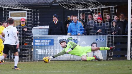 Joe Welch makes a diving save for Royston Town. Picture: DANNY LOO