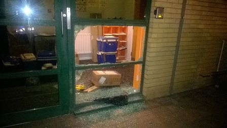 Damage to the door of a business caused during the break-ins. Picture: CAMBS POLICE