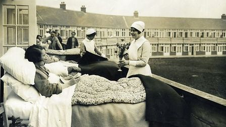 Beds were pushed onto the balconies at Papeworth so that TB patients could have fresh air.