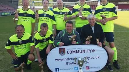 The Huntingdon Walking Football Group celebrate their tournament triumph. Picture: SUBMITTED